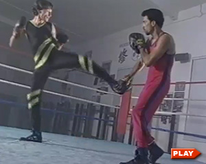Nicolas Saignac practicing savate with trainer